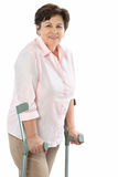 Senior woman on crutches Royalty Free Stock Images