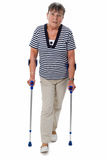 Senior woman on crutches Royalty Free Stock Image