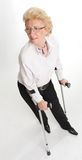 Senior woman with crutches Stock Photography