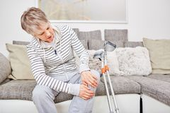 Senior woman with crutches and injury royalty free stock photography