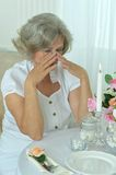 Senior woman crying in room Stock Photography
