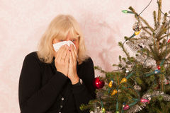 Senior woman is crying white Christmas holidays Royalty Free Stock Images