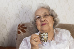 Senior woman with cup of coffee Royalty Free Stock Photo