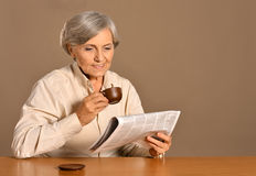 Senior woman with cup Royalty Free Stock Photos