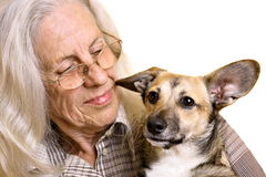 Senior woman with cute puppy Stock Photography