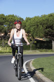 Senior Woman On Cycle Ride Royalty Free Stock Images