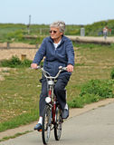 Senior woman cyclist Royalty Free Stock Photography