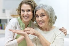 Senior woman with daughter Stock Image