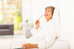Senior woman daydreaming Stock Photography