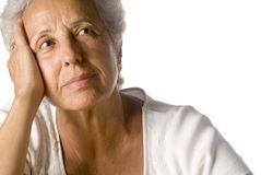 Senior woman daydreaming. On white background Royalty Free Stock Image