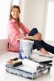 Senior woman decorating house stock photo