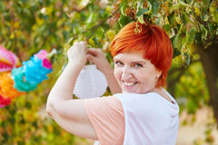 Senior woman decorating for a party Royalty Free Stock Photography