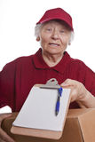Senior woman delivering a parcel Royalty Free Stock Images