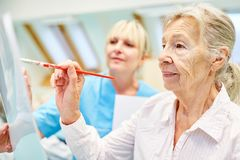 Senior woman with dementia in creative painting class royalty free stock photos