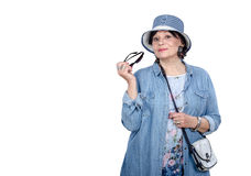 Senior woman in denim hat and coat posing on white background Royalty Free Stock Images