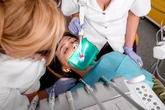 Senior woman on the dental operation. Royalty Free Stock Photo