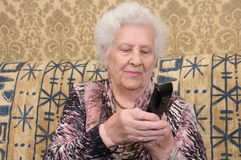 Senior woman dials the phone Stock Photos