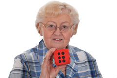 Senior woman with dice Stock Images