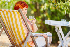 Senior woman dinking a glass of water Stock Photos