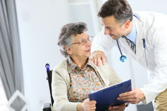 Senior woman discussing with the doctor Stock Photo