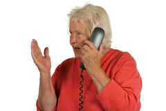 Senior woman is discussing while telephoning Stock Photography