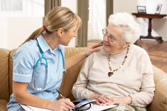 Senior Woman In Discussion With Health Visitor Stock Images