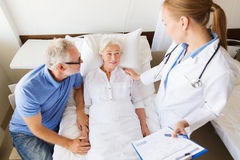 Senior woman and doctor with clipboard at hospital Royalty Free Stock Photography