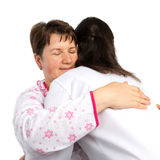 A senior woman and doctor hugging Stock Photos