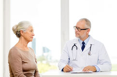 Senior woman and doctor meeting Royalty Free Stock Photos