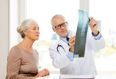 Senior woman and doctor meeting Stock Images