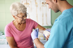 Senior woman at doctor's office Royalty Free Stock Photo