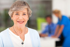 Senior woman doctor's office Royalty Free Stock Image