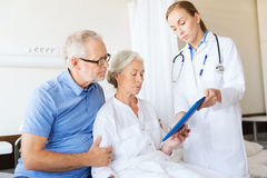 Senior woman and doctor with tablet pc at hospital Stock Image