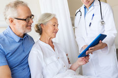 Senior woman and doctor with tablet pc at hospital Royalty Free Stock Photography