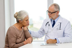 Senior woman and doctor with tablet pc Royalty Free Stock Image