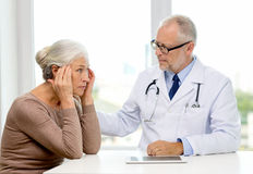 Senior woman and doctor with tablet pc Stock Photo