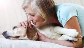 Senior woman and dog Royalty Free Stock Photo