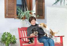 Senior woman with dogs Royalty Free Stock Photos