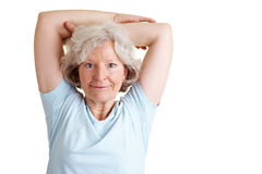 Senior woman doing back training Royalty Free Stock Image