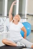 Senior woman doing breathing. Exercise in fitness center Stock Photos