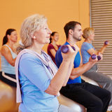 Senior woman doing dumbbell Stock Photography