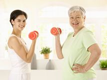 Senior woman doing dumbbell exercise Royalty Free Stock Image