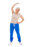 Senior woman doing fitness exercises Stock Photos