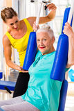 Senior woman doing fitness sport in gym or health club Stock Photo