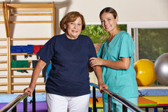 Senior woman doing kinesiotherapy Royalty Free Stock Photography