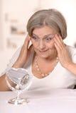Senior woman doing makeup Royalty Free Stock Image