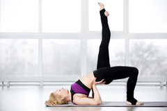 Senior woman doing shoulder bridge exercise Stock Image