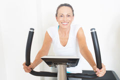 Senior woman doing spinning royalty free stock photo
