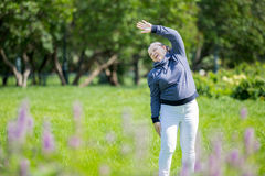 Senior woman doing sport in park Royalty Free Stock Image