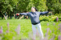 Senior woman doing sport in park Royalty Free Stock Photos